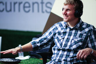 Person using hand motion to control SENSE system